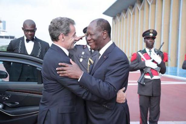 Côte d'Ivoire : tapis rouge pour Nicolas Sarkozy à Abidjan